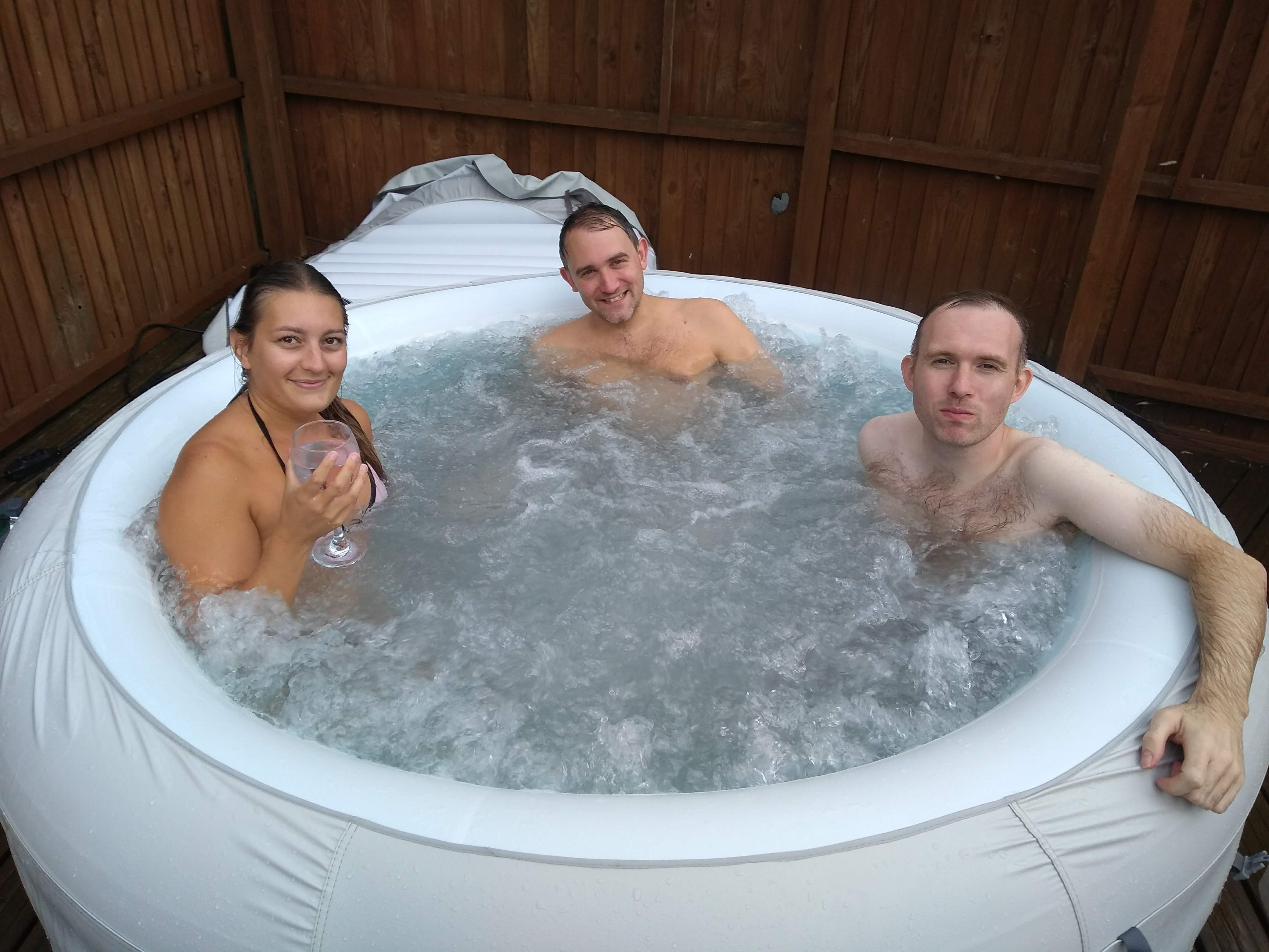 Lauren, Graeme and Greg fully in the hot tub