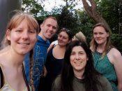 Kim, Greg, Lauren, Laura and Lucy standing in a queue line taking a selfie.